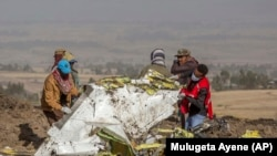 Rescuers work at the scene of an Ethiopian Airlines flight crash in Ethiopia, Monday, March 11, 2019.