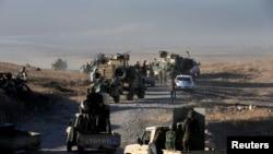 Курдское военнизированное формирование Пешмерга на подступе к иракскому городу Мосул. 17 октября 2016 года.