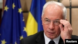 Ukrainian Prime Minister Mykola Azarov awaits the start of a European Union-Ukraine cooperation council in Brussels on May 15.