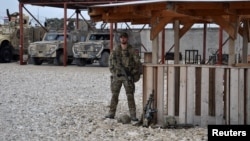 A soldier stands guard at Camp Shaheen in Mazar-e Sharif. (file photo)