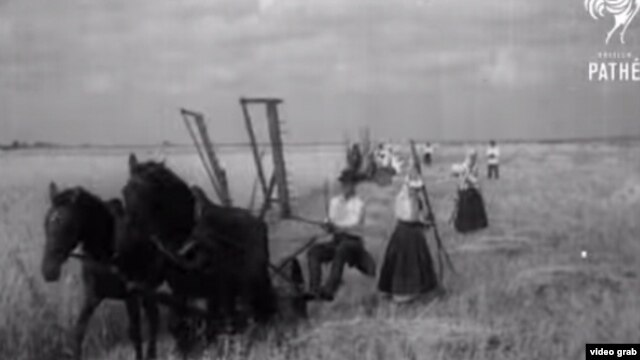 "A screen shot of Ukrainian peasants from ""The Harvesters' Song,"" a British Pathé news clip that was made in 1935"