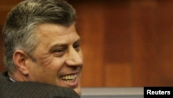 Kosovo -- Hashim Thaci smiles after his re-election as Prime Minister at the parliament in Pristina, 22Feb2011