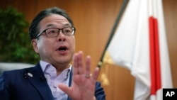Japan's Trade Minister Hiroshige Seko speaks during an exclusive interview with The Associated Press at his office in Tokyo Thursday, Aug. 23, 2018. Seko criticized President Donald Trump's tariff policies as based on a serious misunderstanding about the