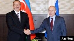 Ильхам Алиев (слева) и Владимир Путин.