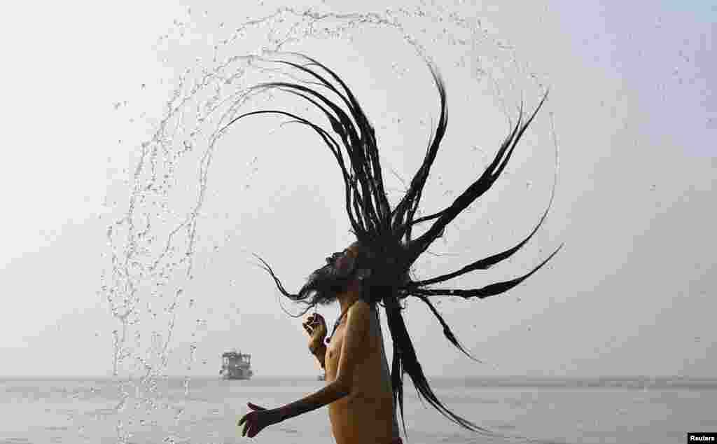 "A ""Sadhu,"" or a Hindu holy man, takes a dip at the confluence of the Ganges River and the Bay of Bengal ahead of the Makar Sankranti festival on Sagar Island, south of Kolkata, India. (Reuters/Rupak De Chowdhuri)"