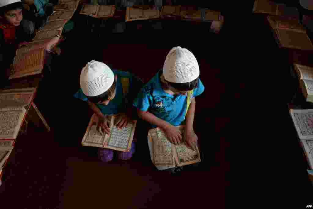 Afghan children read the Koran during the Islamic holy month of Ramadan at a mosque in Mazar-e Sharif. (AFP/Farshad Usyan)