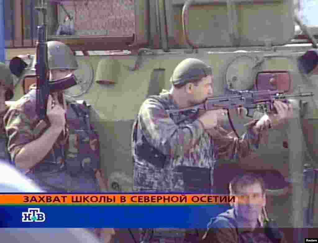 A screen grab from Russian NTV shows special forces soldiers outside the school.