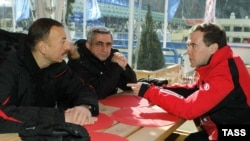 Russian President Dmitry Medvedev (right) meets with his Azerbaijani and Armenian counterparts Ilham Aliyev (left) and Serzh Sarkisian in the Russian ski resort of Krasnaya Polyana on March 5.
