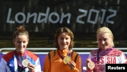 Cycling gold medalist Marianne Vos of the Netherlands (center) poses alongside silver-medalist Elizabeth Armitstead of Britain and bronze-medalist Olga Zabelinskaya of Russia.