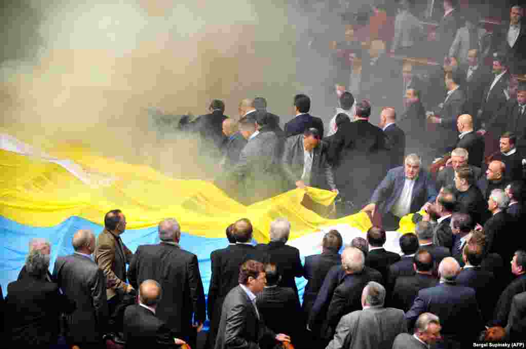 Smoke bombs and a giant flag made Ukraine's parliament look more like a gathering of football ultras than an assembly of politicians during the debate on Russia's Crimea base in April 2010.