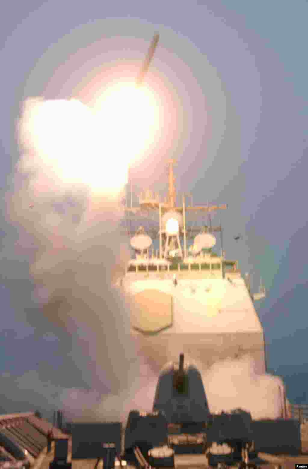 The first Tomahawk missile to be fired into Iraq is launched from the USS Bunker Hill in the Persian Gulf early on March 20, 2003.