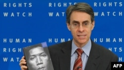 Kenneth Roth, the executive director of Human Rights Watch, presents the findings of the new report during a press briefing in Brussels.