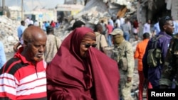 Somali woman mourns at the scene of an explosion in Mogadishu
