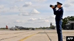 A Russian Air Force officer takes photos of the joint Russian-Serbian military exercises at an airport in Batajnica, near Belgrade, on October 13.