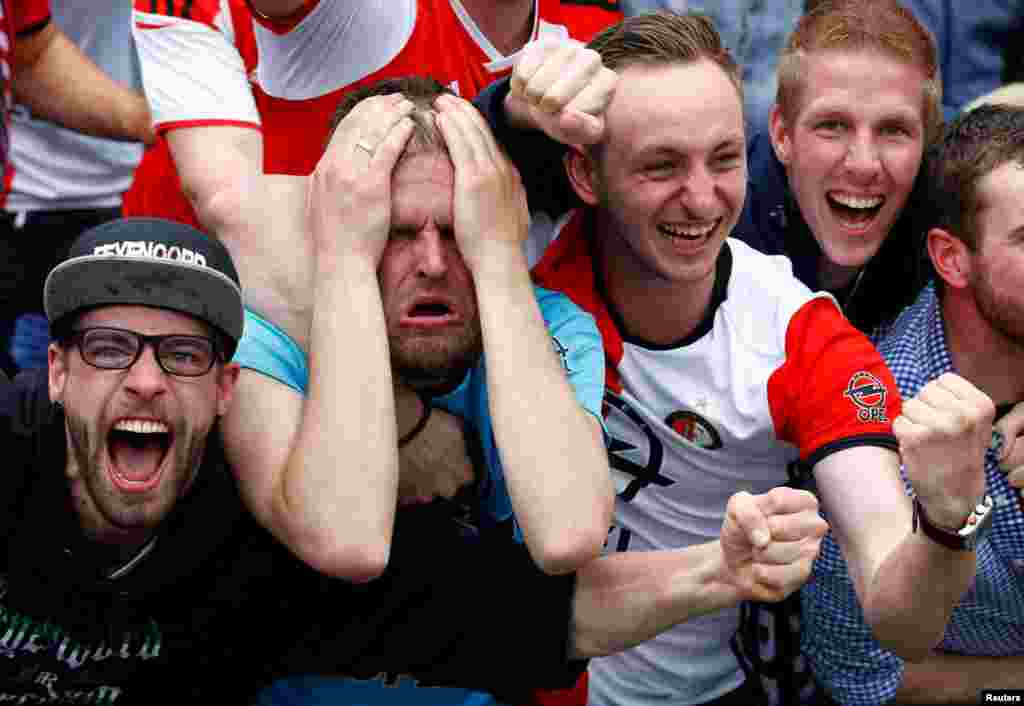 Soccer supporters react as Feyenoord Rotterdam score a goal in a Dutch league match against Heracles Almelo. (Reuters/Michael Kooren)