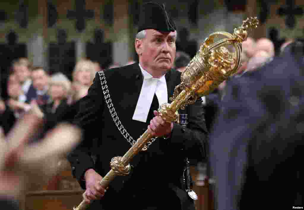 Sergeant-at-Arms Kevin Vickers is applauded in the House of Commons in Ottawa, Canada, on October 23. Vickers was credited with killing a gunman who went on a rampage in the Canadian parliament, killing a Canadian soldier before being shot by Vickers. (Reuters/Chris Wattie)