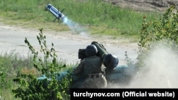A Ukrainian soldier launches a U.S. antitank missile during training outside Kyiv in May 2018.