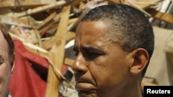U.S. President Barack Obama views damage caused by severe storms and tornadoes in the Tuscaloosa, Alabama