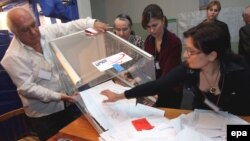 Local election commission members opening a ballot box at a polling station in Tbilisi after May 2008 voting.