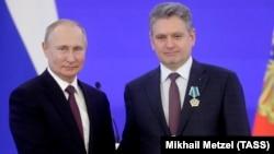 Vladimir Putin (solda) və Nikolai Malinov