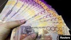 Казахстанская валюта - тенге. Иллюстративное фото.