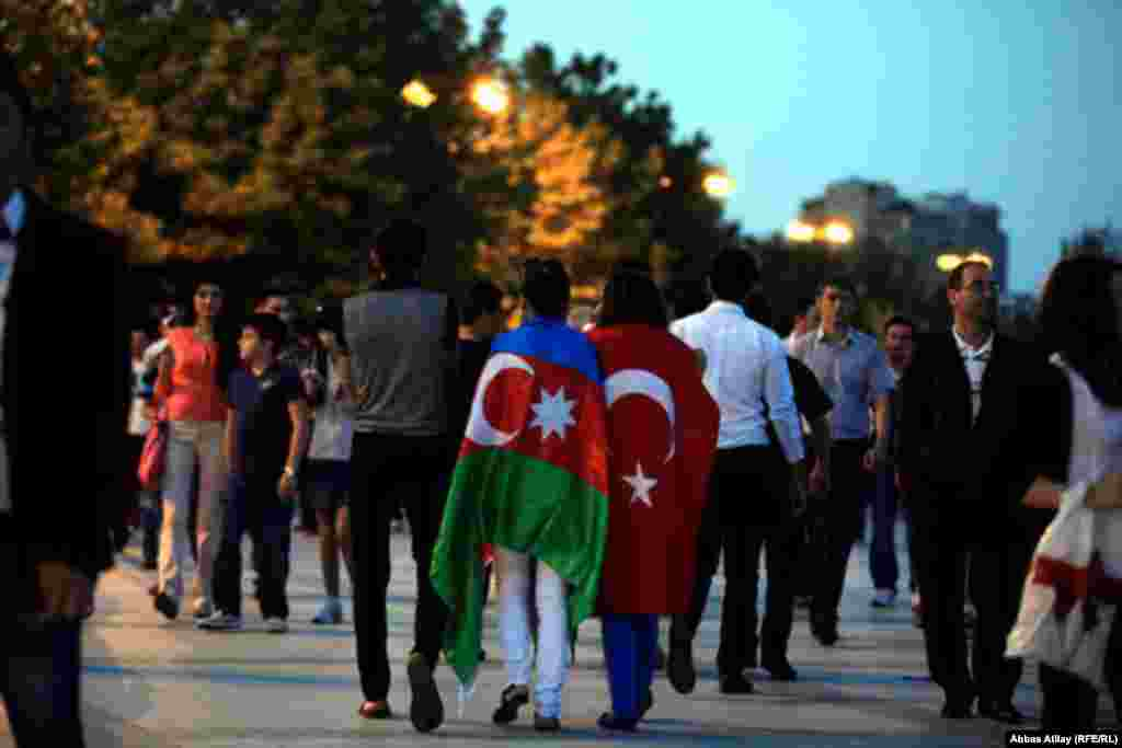 Fans carry the flags of Azerbaijan, Turkey...