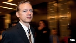 WikiLeaks founder Julian Assange arrives for a press conference in London on October 23 to release previously secret files on the Iraq war.