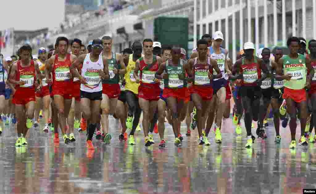 Athletes run in the men's marathon. Eliud Kipchoge of Kenya won gold.