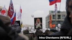 Opposition supporters at a December 24 rally in Moscow protest alleged violations in recent parliamentary elections and the policies of current Prime Minister Vladimir Putin.