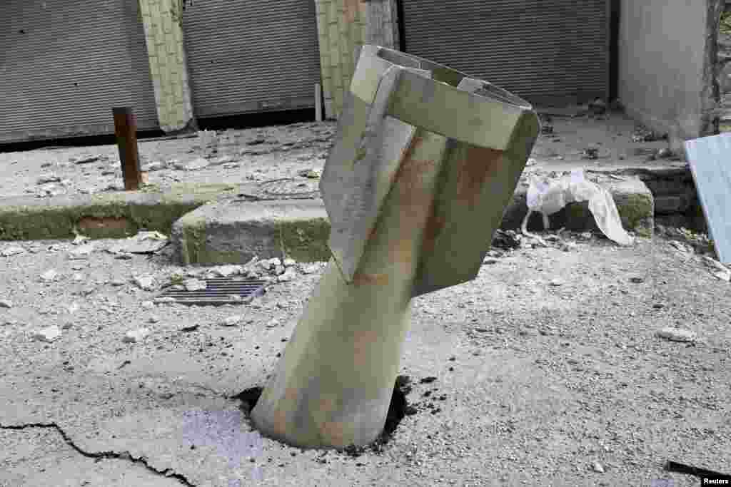 An unexploded bomb is seen in the Ain Terma area in Ghouta, east of the Syrian capital, Damascus. (Reuters/Karm Seif/Shaam News Network)