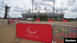 U.K. -- Paralympic Games signs are seen in front of the Olympic Stadium in the Olympic Park at Stratford, east London, 22Aug2012