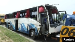 Serbian police says the deadly crash occurred when a Slovak bus swerved off the highway connecting Belgrade and Skopje.