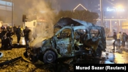 A car bomb hit a police vehicle late on December 10 shortly before a suicide bomber detonated a suicide vest outside a stadium in Istanbul.
