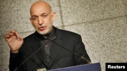 Afghan President Hamid Karzai delivers a speech during a seminar hosted by the Japan Institute of International Affairs in Tokyo on June 18.