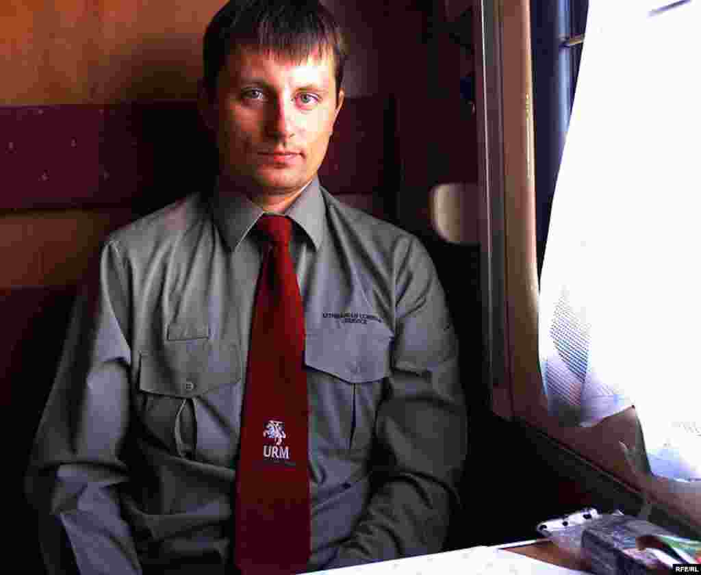 Liutauras Barila is a Lithuanian consular official on the train. Before the train reaches the border crossing, he passes through the cars distributing FRTDs, valid for a return trip within three months. The document is given free of charge.