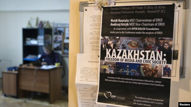 """A reporter at work in the office of the """"Golos respubliki"""" newspaper in Almaty, which was the first to face closure."""