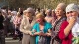 GRAB - Hundreds Turn Out At Kazakh Activist's Funeral