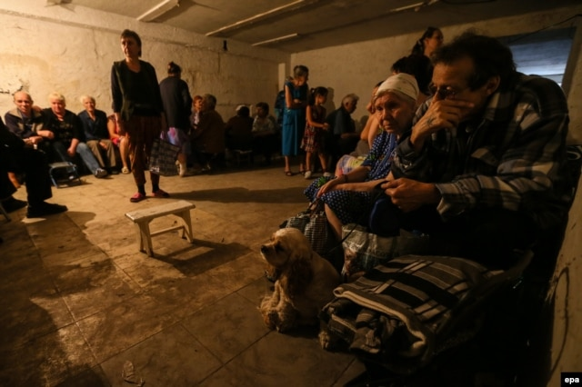 Residents hide in a shelter in Makeyevka near Donetsk in mid-August.