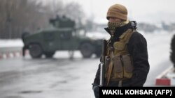An Afghan soldier guards the site of an attack near the Marshal Fahim Military Academy in Kabul on January 29.