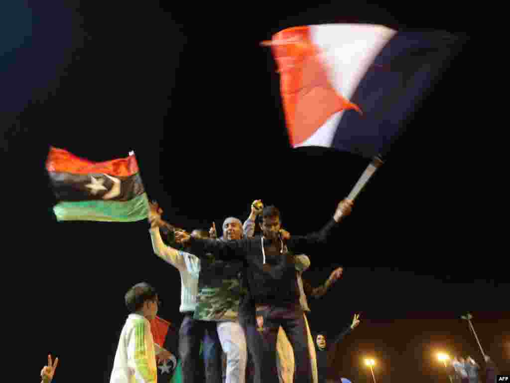 Libyans celebrate in Benghazi on March 17 the UN Security Council's resolution to impose a no-fly zone over Libya. Photo by Patrick Baz for AFP