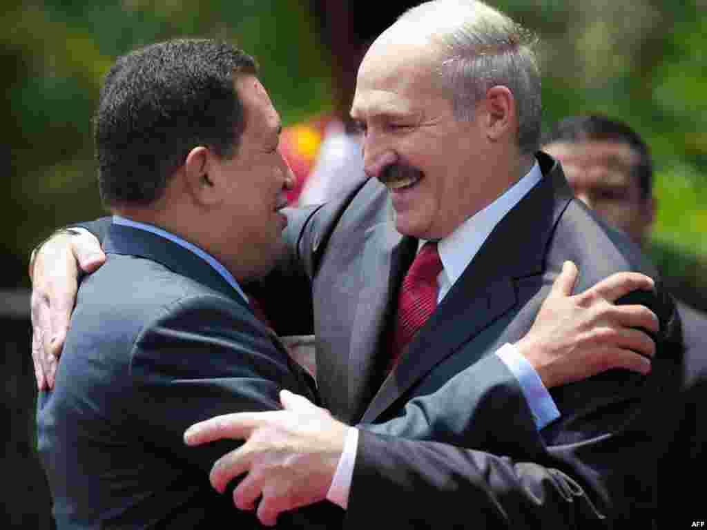 "Venezuela -- Venezuelan Presidente Hugo Chavez (L) and Belarussian President Alexander Lukashenko hug each other at the ""Miraflores"" presidential palace in Caracas, 15Mar2010"