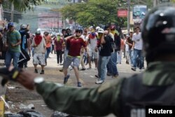 Сутыкненьні паміж паліцыяй і дэманстрантамі, якія патрабавалі адстаўкі прэзыдэнта Мадура, кастрычнік 2016 году.