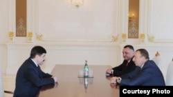 President of Azerbaijan Ilham Aliev (right) meets Belarus KGB chief Vadim Zaycau (Left), May 3, 2011