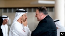 Secretary of State Mike Pompeo, right, and United Arab Emirates Foreign Minister Sheikh Abdullah bin Zayed Al Nahyan, left, speak together at the Al Shati Palace in Abu Dhabi‎, United Arab Emirates, Tuesday, July 10, 2018 to travel to Brussels. Pompeo is