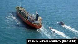 Boats from Iran's Islamic Revolutionary Guards Corps seize a South Korean-flagged tanker named Hankuk Chemi in the Persian Gulf on January 4.