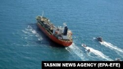 A photo made available by Iran's Tasnim news agency shows Iranian forces seizing the South Korean-flagged MT Hankuk Chemi in the Persian Gulf on January 4.