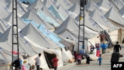 Сирийские беженцы в лагере Каркамис 16 января 2014 года