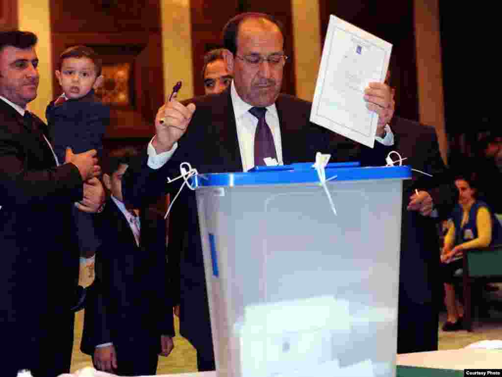 Iraqi Prime Minister Nuri al-Maliki casts his vote.