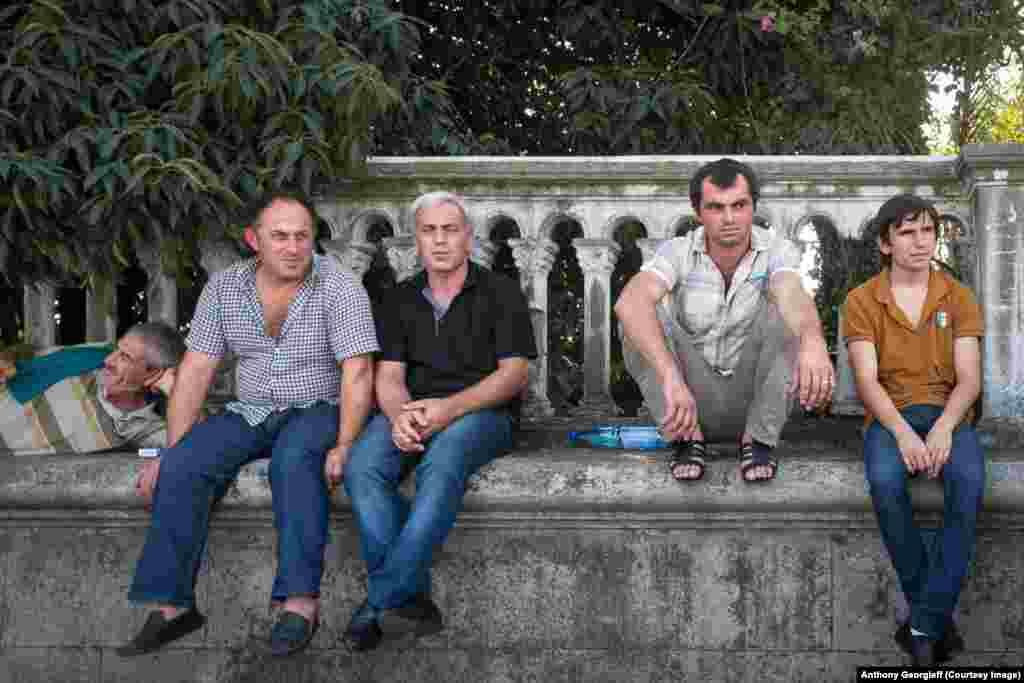 Men relax in Sukhumi. Precise statistics are not available, but locals claim unemployment reaches 80 percent in some parts of Abkhazia.