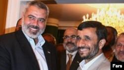 Результаты первого свободного волеизъявления палестинских избирателей не обрадовали Запад. Премьер Исмаил Хания (слева) в Иране